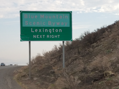 Faded sign at Lexington exit from I-84
